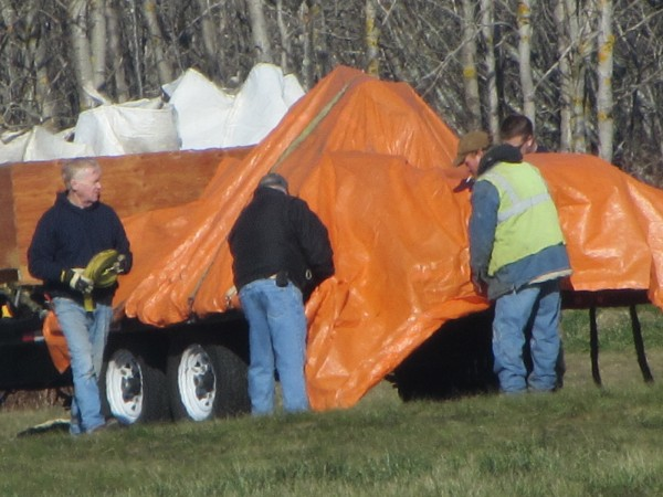 Wreckage from a plane that crashed Friday evening at the Knox County Regional Airport in Owls Head is on a flatbed truck that will be taken to a storage facility in Biddeford.