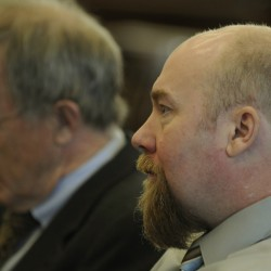 Defendant takes stand in murder trial, pleads guilty to gun charge