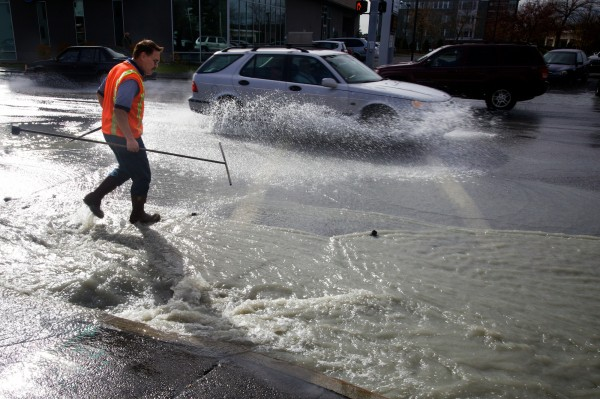 A workman from the Portland Water District prepares to shut off a water main break on outer Congress Street in Portland on Friday, Nov. 2, 2012. Traffic is expected to be snarled for the rest of the day while it is repaired.