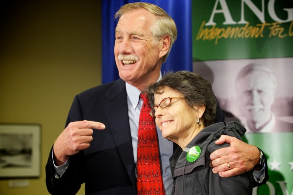 Senator-elect Angus King drags his reluctant wife, Mary Herman, on stage at the end of a press conference in Freeport on Wednesday Nov. 7, 2012, thanking her for her support.