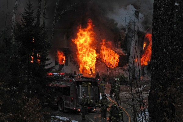 Firefighters battle the blaze that destroyed this Stackpole Way home in Ellsworth on Nov. 8, 2012. The next day, investigators with the state fire marshal's office deemed the fire suspicious, and the homeowner, Dayton Arey, took his own life.