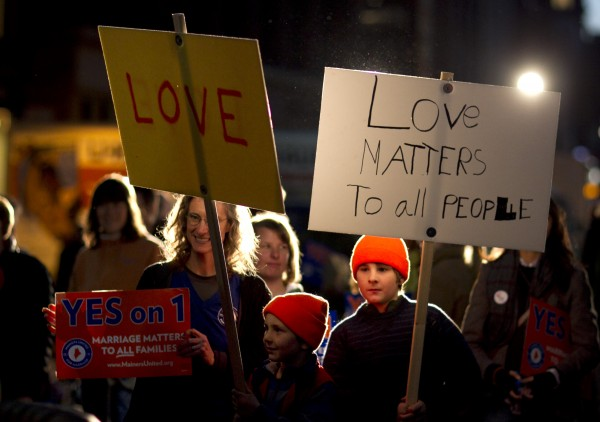 Heidi Henninger, left, and her sons, Zack, 7, and Nate, 9, show their support for gay marraige at a rally in downtown Portland, Maine, Thursday, Nov. 1, 2012, in a final campaign push before Tuesday's vote on a same-sex marriage referendum.