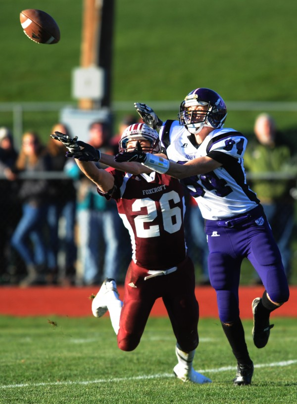 John Bapst's Josh Baker snags an interception from Foxcroft Academy Pony Don Boyer during third-quarter action at Dover-Foxcroft on Saturday, Nov. 10, 2012. Foxcroft won 33-7 and will face Winslow in the state game next Saturday in Portland.