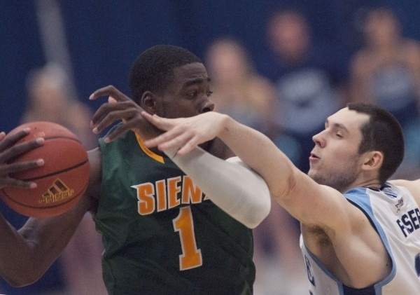 UMaine men's basketball player Alasdair Fraser (15) gets in the way of Siena College player O.D. Anosike (1) in the second half of their college basketball game in Orono on Sunday, Nov. 25, 2012.