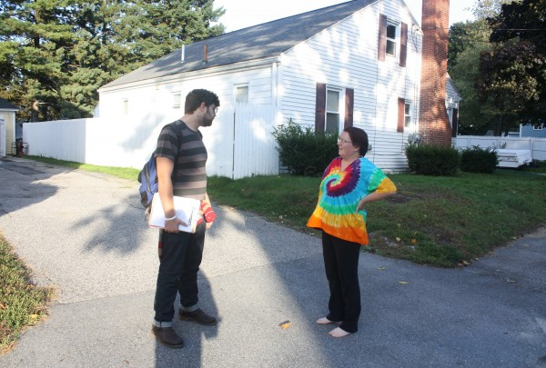 Owen Hill, a staffer for Mainers United for Marriage, talks to a voter about same sex marriage in Westbrook on October 1, 2012.