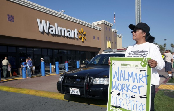 Angelita Rodriguez protests outside a Walmart store in Paramount, Calif., Friday Nov. 23, 2012. Wal-Mart employees and union supporters are taking part in today's nationwide demonstration for better pay and benefits A union-backed group called OUR Walmart, which includes former and current workers, staged the demonstrations and walkouts at hundreds of stores on Black Friday.