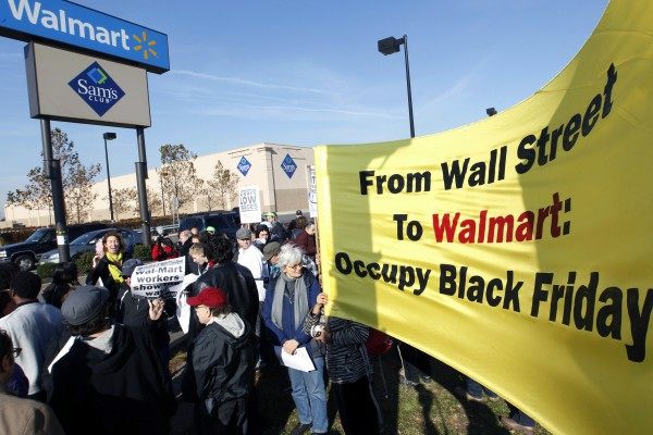 Occupy Wall Street's &quot99 Picket Lines&quot working group, joins a protest against Wal-Mart on Black Friday, Nov 23, 2012, in Secaucus, N.J.  Wal-Mart employees and union supporters are taking part in today's nationwide demonstration for better pay and benefits A union-backed group called OUR Walmart, which includes former and current workers, was staging the demonstrations and walkouts at hundreds of stores on Black Friday, the day when retailers traditionally turn a profit for the year.