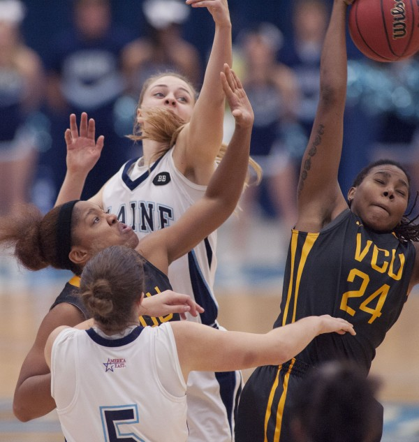 UMaine women's basketball players Danielle Walczak (5) and Liz Wood (31)   scramble for a rebound with Virginia Commonwealth players Shekinah Henry (left) and Robyn Parks (24)  in the second half of their college basketball game in Orono on Saturday, Nov. 24, 2012.