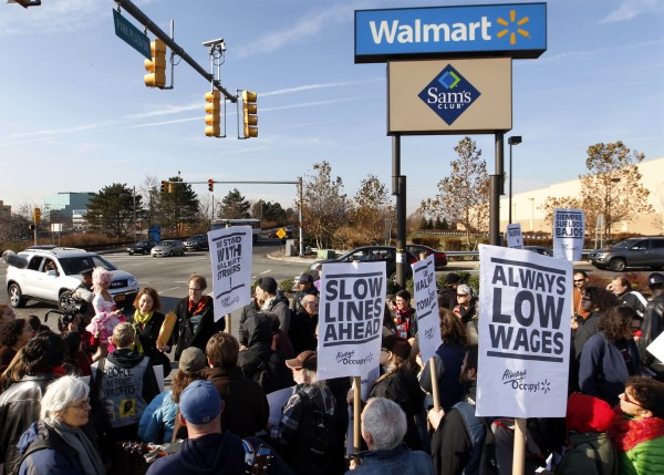 A large gathering protests against Wal-Mart on Black Friday, Nov 23, 2012, in Secaucus, N.J.  Wal-Mart employees and union supporters are taking part in today's nationwide demonstration for better pay and benefits A union-backed group called OUR Walmart, which includes former and current workers, was staging the demonstrations and walkouts at hundreds of stores on Black Friday.