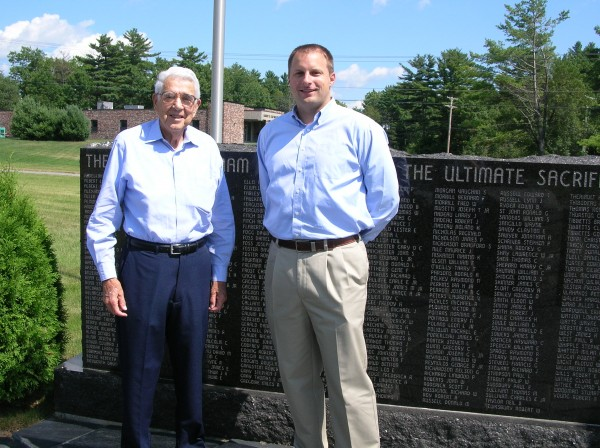 Galen Cole (left), founder of Cole Land Transportation Museum who was mayor of Bangor in 1958, talks with current Mayor Cary Weston about the planned monument to more than 110 Bangor men who were killed during World War II.