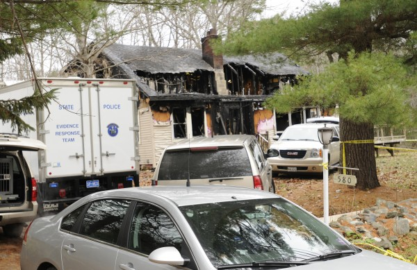 Investigators were still on the scene at 580 Dow Road in Orrington on Sunday after a Saturday fire damaged the home and left a man and his three children dead.