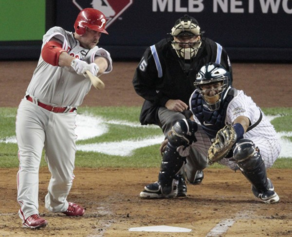 Philadelphia Phillies' Matt Stairs hits a run scoring single during the second inning of Game 2 of the Major League Baseball World Series Thursday, Oct. 29, 2009, in New York. New York Yankees' Jose Molina is catching. Umpire is Jeff Nelson.