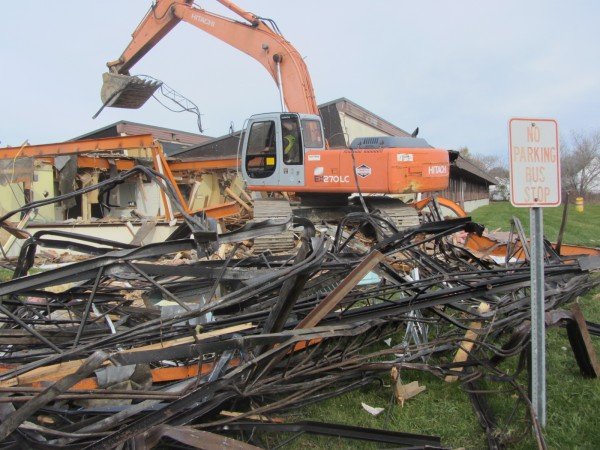 Demolition of the former MacDougal School began Friday in Rockland. The school opened in 1954, but has been closed for two years.