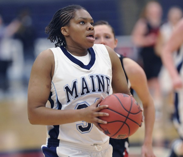 University of Maine women's basketball team plays U New Brunswick in exhibition in Orono, Maine, Thursday Oct. 29, 2012.  Maine player Chantel Charles drives to the hoop in the second half of their game.