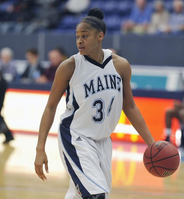 University of Maine women's basketball team plays U New Brunswick in exhibition in Orono, Maine, Thursday Oct. 29, 2012. Maine player Corinne Wellington collects the ball under the basket in the first half of their game.