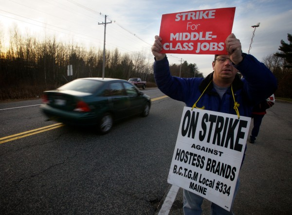 Striking Hostess worker Bill Kennedy holds a sign outside the plant in Biddeford on Tuesday, Nov. 20, 2012.