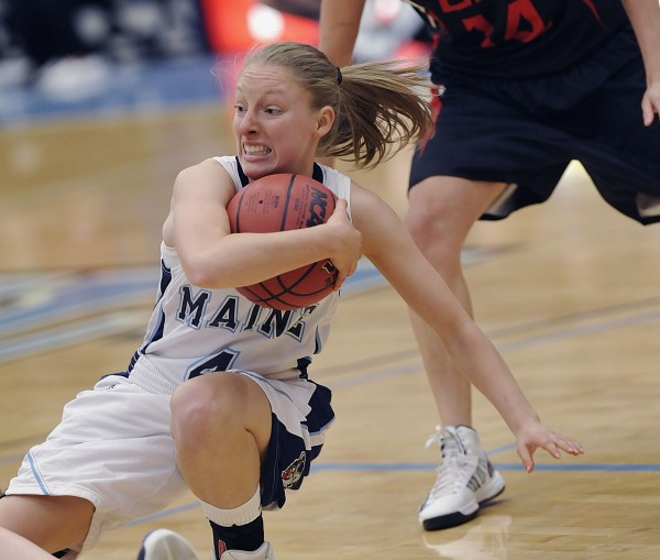 University of Maine women's basketball team plays U. New Brunswick in exhibition in Orono, Maine, Thursday Oct. 29, 2012.  Maine player Courtney Anderson grabs a rebound as she falls in the first half of their game.