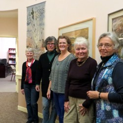 The members of the Boyd Place Art Committee pose in front of a few works of art that they recently hung on the walls for their current exhibition. They are Jane Burger, left, Nina Jerome, LeeAnne Mallonee, Sarah Clark and Fran Clukey.