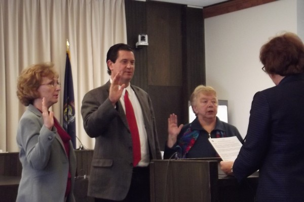 Bangor City Clerk Lisa Goodwin (right) swears in Councilors (from left) Pauline Civiello, David Nealley and Patricia Blanchette, during a meeting Wednesday, Nov. 14, 2012.