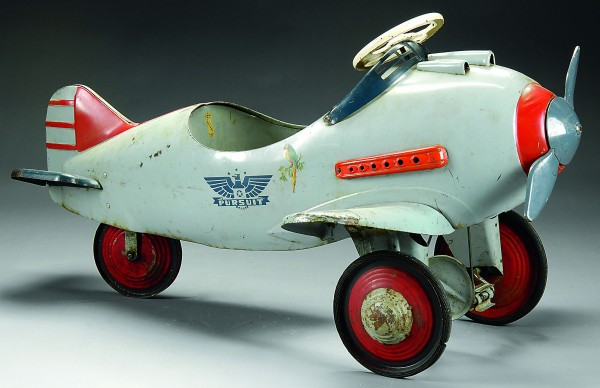 This early 1940s Murray Pursuit plane child''s pedal car with army decals and machine gun mounts sold for $1,265 along with another pedal car in a James D. Julia toy auction this summer.