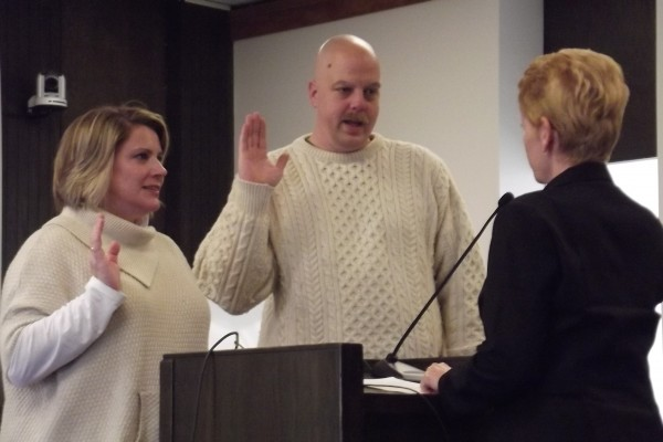 Bangor School Committee members Sarah Smiley (left) and Marc Eastman (center) take an oath during a swearing-in ceremony Wednesday, Nov. 11, 2012, in City Council Chambers.