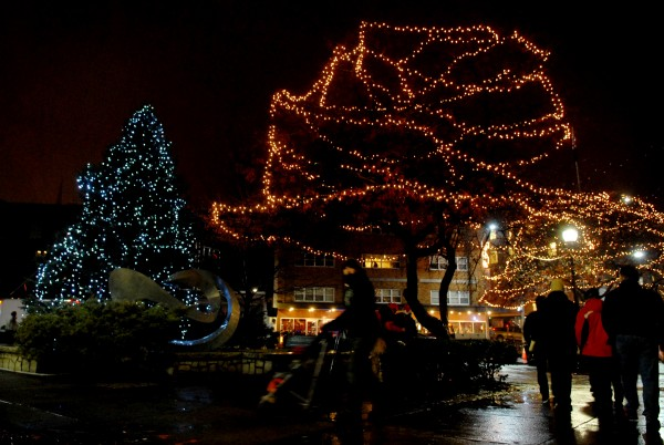 People walk past the Christmas tree in downtown Bangor following the Festival of Lights Parade and tree lighting in December 2010.