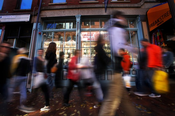 Shoppers throng on Exchange Street in Portland Friday, Nov. 23, 2012, in this time-lapse photo. The greater Portland metro area now counts for more than half the state's economic output.