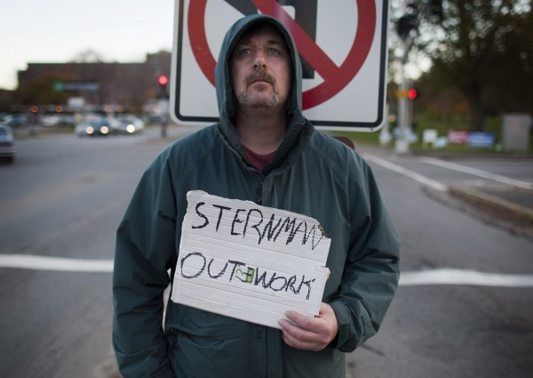 Robert Macie, who sleeps at the Oxford Street shelter, holds a sign on a median on Forest Avenue in Portland. &quotSome people don'€™t understand what a sternman is so I'€™ve had to put lobsterman [on my sign]. Now they'€™re catching on,&quot he said. &quotA good place to stand is at Exit 8 where people are coming off after paying the toll. Just don't cross the street. They'll arrest you in Westbrook.&quot