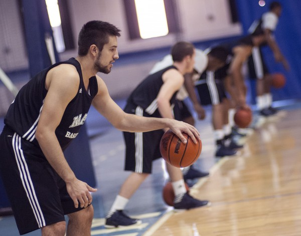 UMaine Men's basketball player Zarko Valjarevic and his teammates  go through warmups in the field house after media day at the 'Pit' in Orono in October.