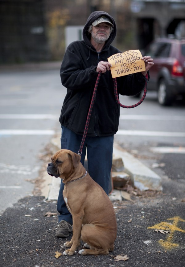 Ken, with his American boxer, Duke, asks for help on a median on Park Avenue in Portland. Ken and Duke spend their nights camping with two homeless friends in Portland. &quotHe's a good dog. I hate to bring him on the corner but sometimes you've got to do what you'€™ve got to do, you know, to provide. I'm not trying to use Duke [to get handouts] but if I didn't have Duke I'€™d still be on the corner,&quot he said.