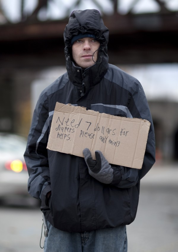 Scott Shepard, 24, asks for help buying diapers at the intersection of Park Avenue and St. John Street in Portland. Shepard shares an apartment with his fiancee and their two children, a daughter, 2, and son, 3. &quotThis is my first time trying it [holding a sign]. I see everybody else down here doing it. I got two kids. I don'€™t believe in collecting welfare, I'd rather work for my money. Not really having any [luck finding] work — so I figured I'€™d give it a shot and see how it goes,&quot he said. &quotI've been out here for like two hours, I got like three bucks. Not too bad, I can't complain, you know.&quot