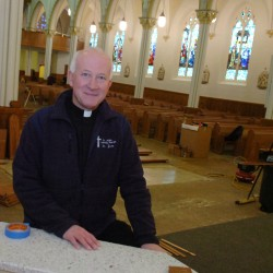 Aroostook pastor cleared in embezzlement probe returns from leave, gives Mass