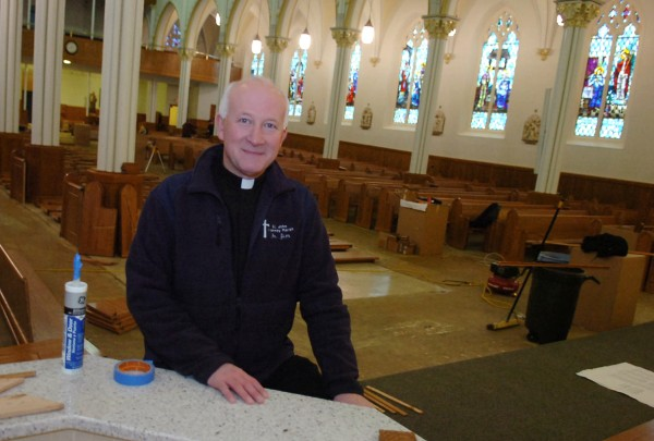 Father James Nadeau sits in the St. Louis Catholic Church in Fort Kent in 2008.