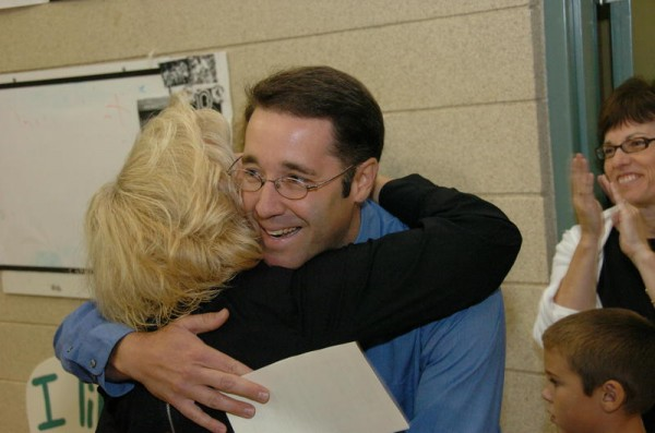 Second-grade teacher Kevin M. Grover gets a hug at D.W. Lunt School in Falmouth in September 2009, after walking into an assembly where he learned he was named 2010 Maine Teacher of the Year. Grover died Thursday, Nov. 22, at his home in Falmouth.
