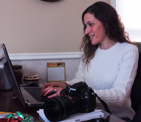 Jill Doucette does some photo editing at her home studio where she this week unveiled The Little Chickadee Project.