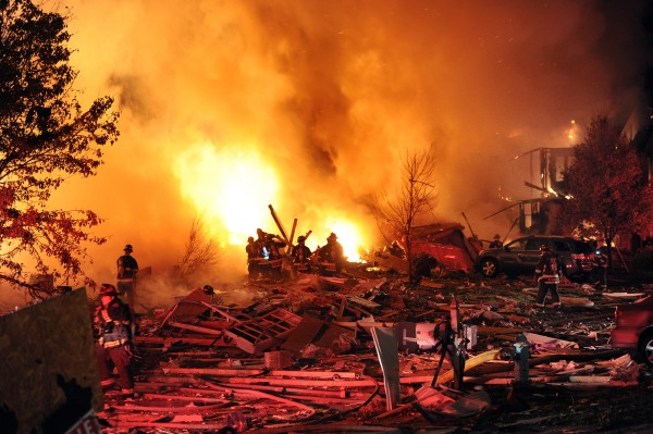 Firefighters work the scene where an explosion has killed two people and damaged more than a dozen homes in the Richmond Hill subdivision, late Saturday, Nov. 10, 2012, in Indianapolis.