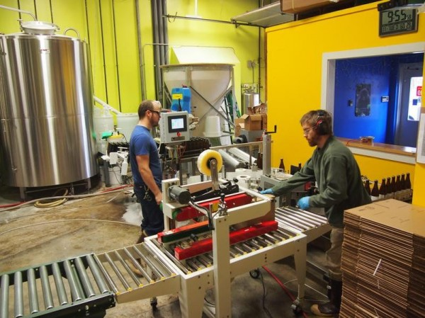 Kevin Glessing, left, and Jared Carr work the bottling line at Maine Beer Co.'s brewery off of Forest Avenue in Portland on Tuesday, Nov. 27, 2012. The brewery is expanding to Route 1 in Freeport, which will allow production to almost double and include a larger tasting room.