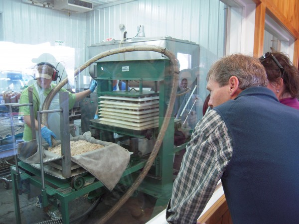 Visitors watch cider being squeezed from apples at the MSAD 1 Educational Farm in Presque Isle on Oct. 2. The farm produced 3,500 gallons of cider in 2011 from apples grown on the farm.