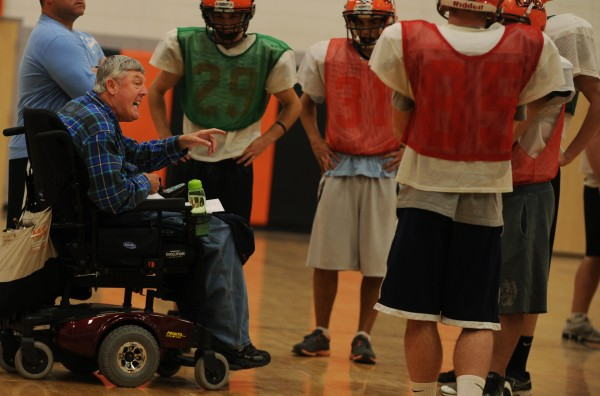 Jim Poulin, left in wheel chair, coaches Winslow High School football players at the high school gym on Tuesday, November 13, 2012. Poulin has MS and says he finds relief from his symptoms while coaching.