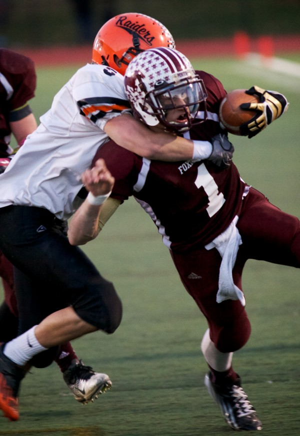Foxcroft Academy quarter back Hunter Law (1) gets taken down after a short gain in the Class C Football State Championship game Saturday.
