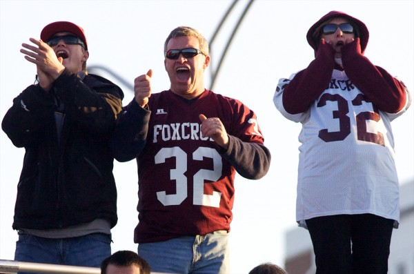 Fans of Foxcroft Academy cheer their team in the Class C Football State Championship game Saturday.
