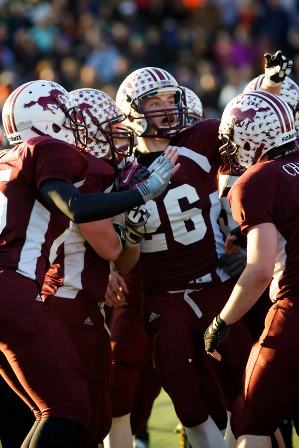Foxcroft Academy running back Donnie Boyer (26) celebrates a touchdown in the Class C Football State Championship game Saturday.