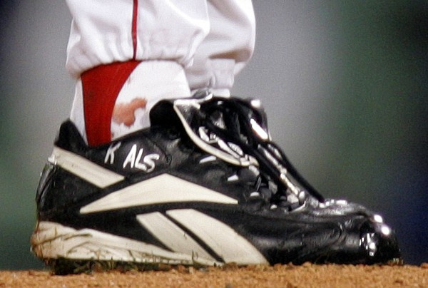 Blood is seen around the ankle of Boston Red Sox pitcher Curt Schilling during the first inning of Game 2 of the World Series in Boston, Sunday, Oct. 24, 2004. Schilling was pitching with a dislocated ankle tendon held together by suture.