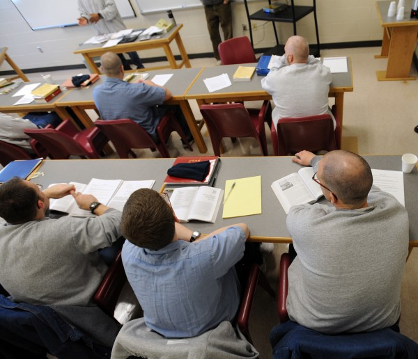 Inmates sit in Patrick Mundy's history class at the Maine State Prison in December 2010. About 40 students are enrolled in the prison college program at the Warren facility that allows them to earn a college degree while behind bars.
