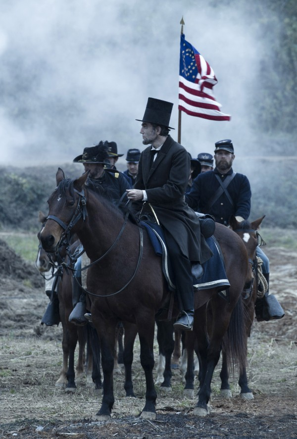 In this undated publicity photo released by DreamWorks and Twentieth Century Fox, Daniel Day-Lewis, center, as President Abraham Lincoln, looks across a battlefield in the aftermath of a terrible siege in this scene from director Steven Spielberg's drama &quotLincoln.&quot