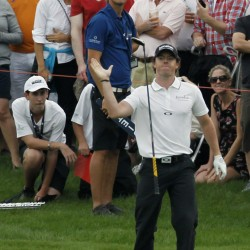 McIlroy moves one ahead at Valhalla; Woods misses cut