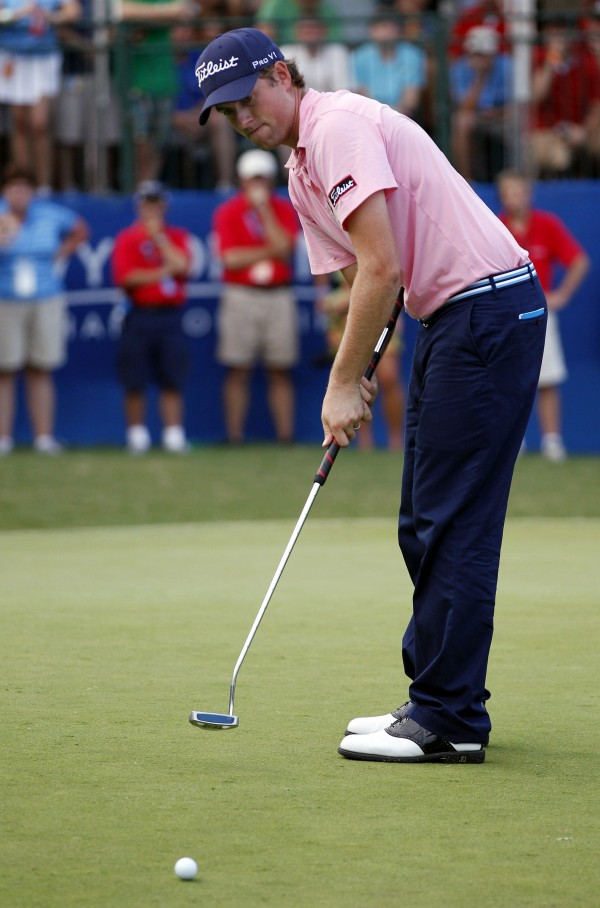 In this Aug. 20, 2011, file photo,Webb Simpson putts on the 18th hole during the third round of the Wyndham Championship golf tournament in Greensboro, N.C. Webb Simpson and Keegan Bradley, two of the major faces in the debate over belly putters, said Tuesday, Nov. 27, 2012, they would not fight a change in the rules if golf's governing bodies decide to outlaw putters anchored to the body.
