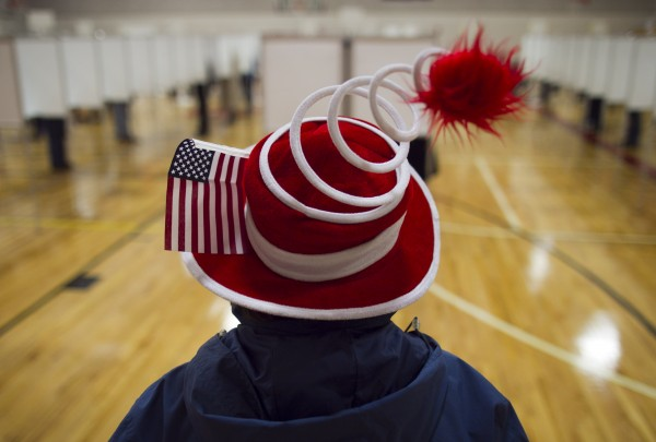 Susan Mardas celebrates Election Day by wearing a festive hat Tuesday, Nov. 6, 2012, while waiting for her mother to vote in Scarborough.