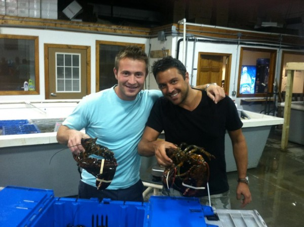 Cousins Jim Tselikis (left) and Sabin Lomac of Cousins Maine Lobster are up to their elbows in lobster recently.