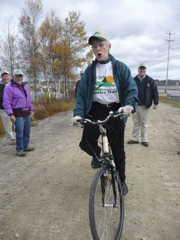 Sally Jacobs, who worked on the rails-to-trails project for the Sunrise Trail Coalition for 20 years, was the first to ride her bicycle on the Down East Sunrise Trail at Machias after a formal ribbon cutting. The multi-use trail runs 32 miles from Machias to Pembroke. Jacobs died after a battle with cancer on Monday, Nov. 12, 2012.